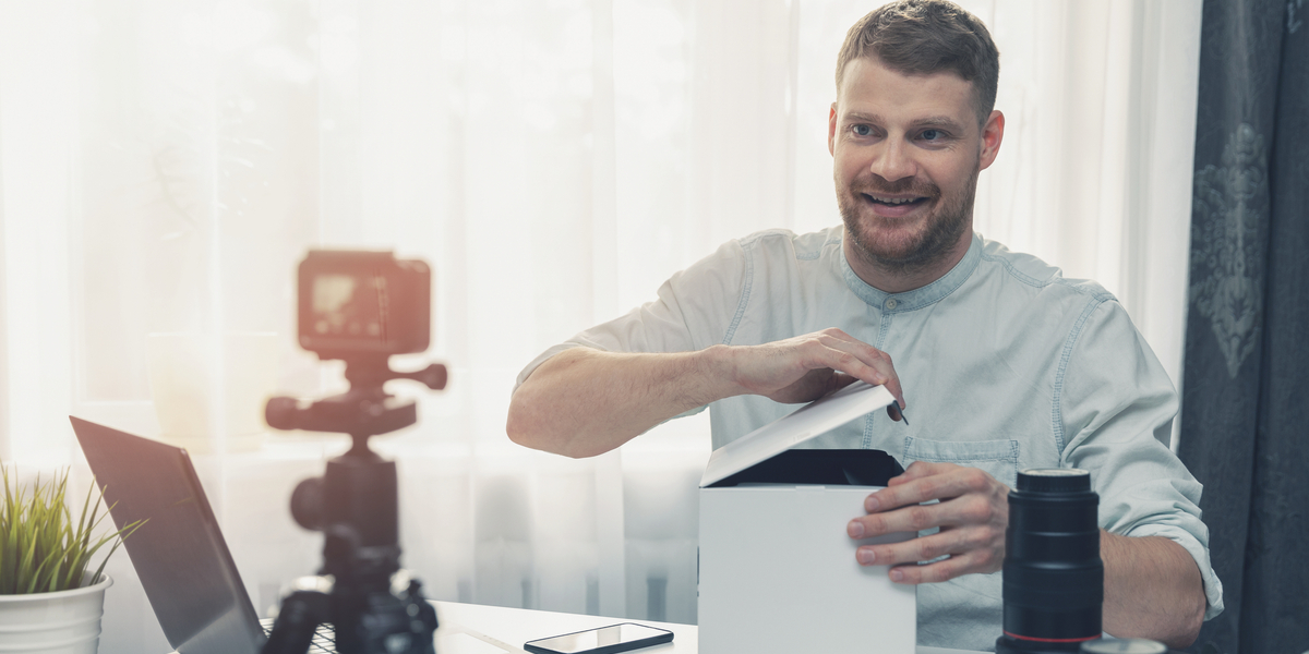 A man live video streaming a tutorial and demo for a new product