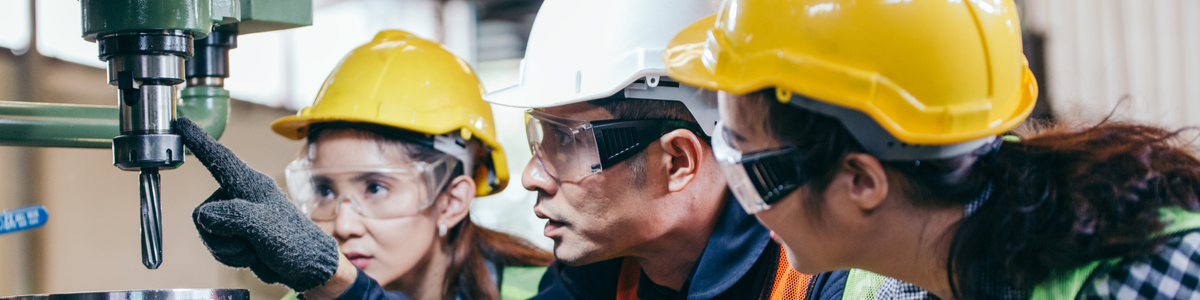 Employees taking safety training in manufacturing