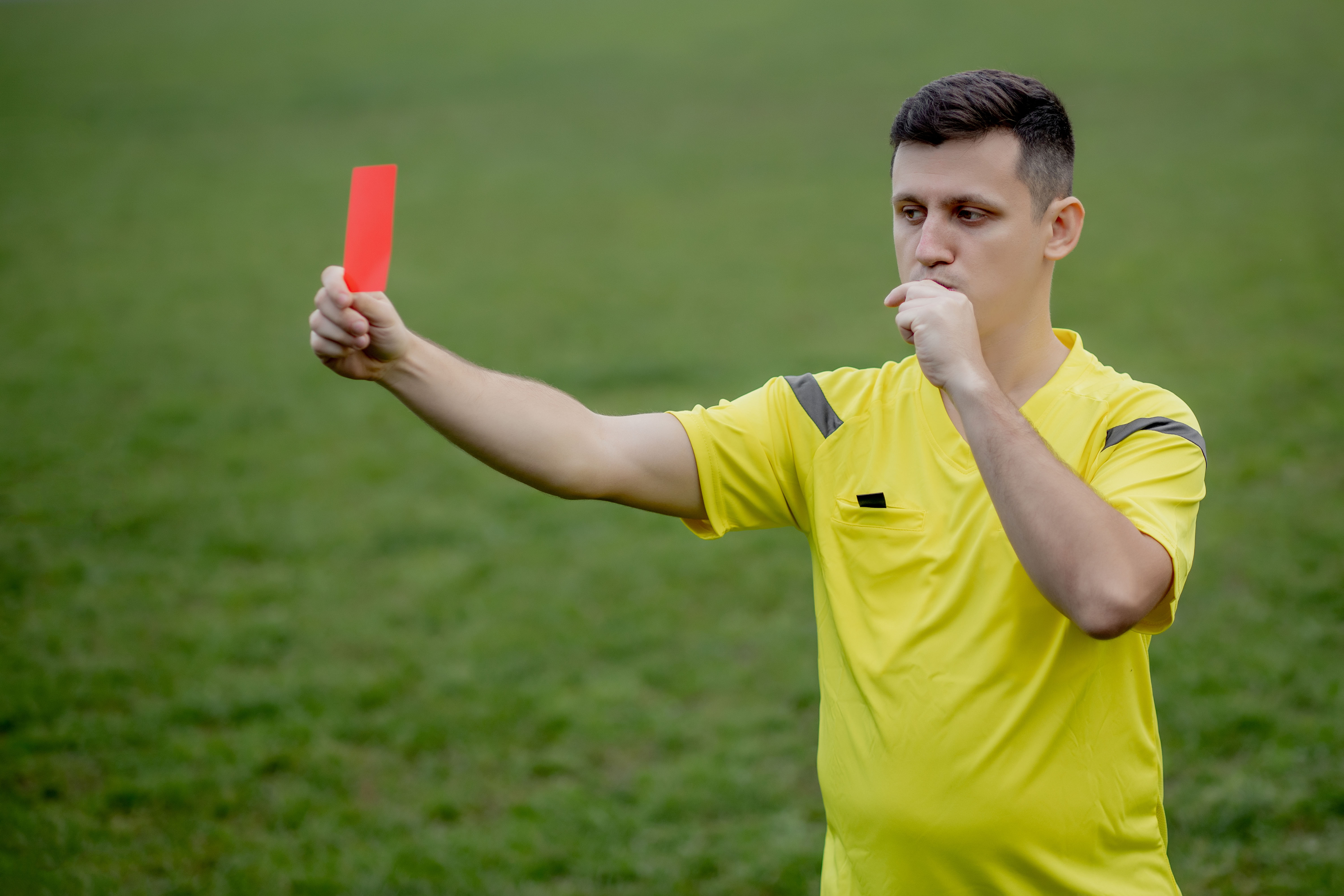 A referee enforcing football rules