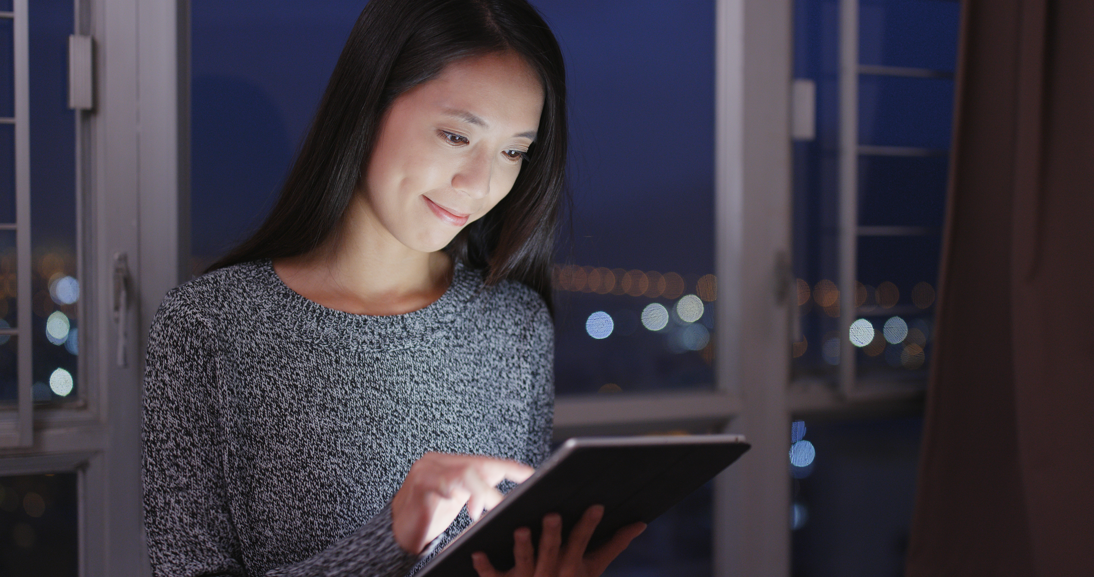 A woman watching training video on an tablet PC