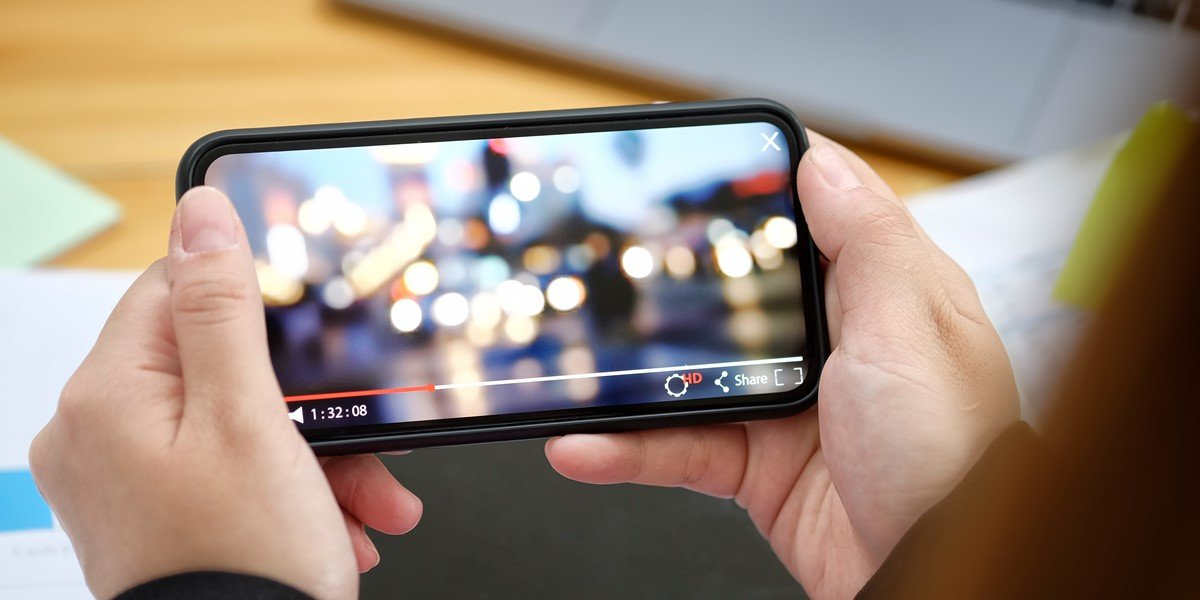 A person watching videos on a Video on Demand (VoD) platform