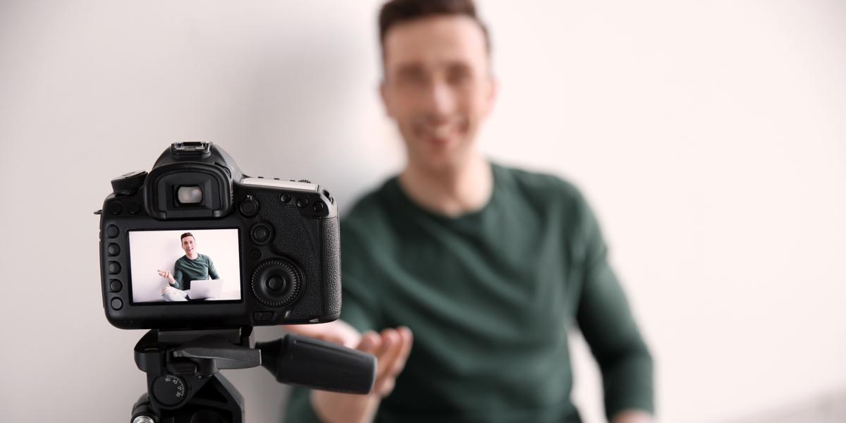 An entrepreneur recording a video to grow his business