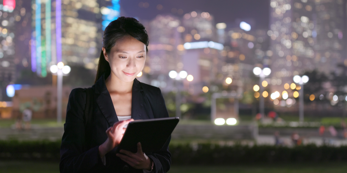 An enterprise worker watching a video on her tablet