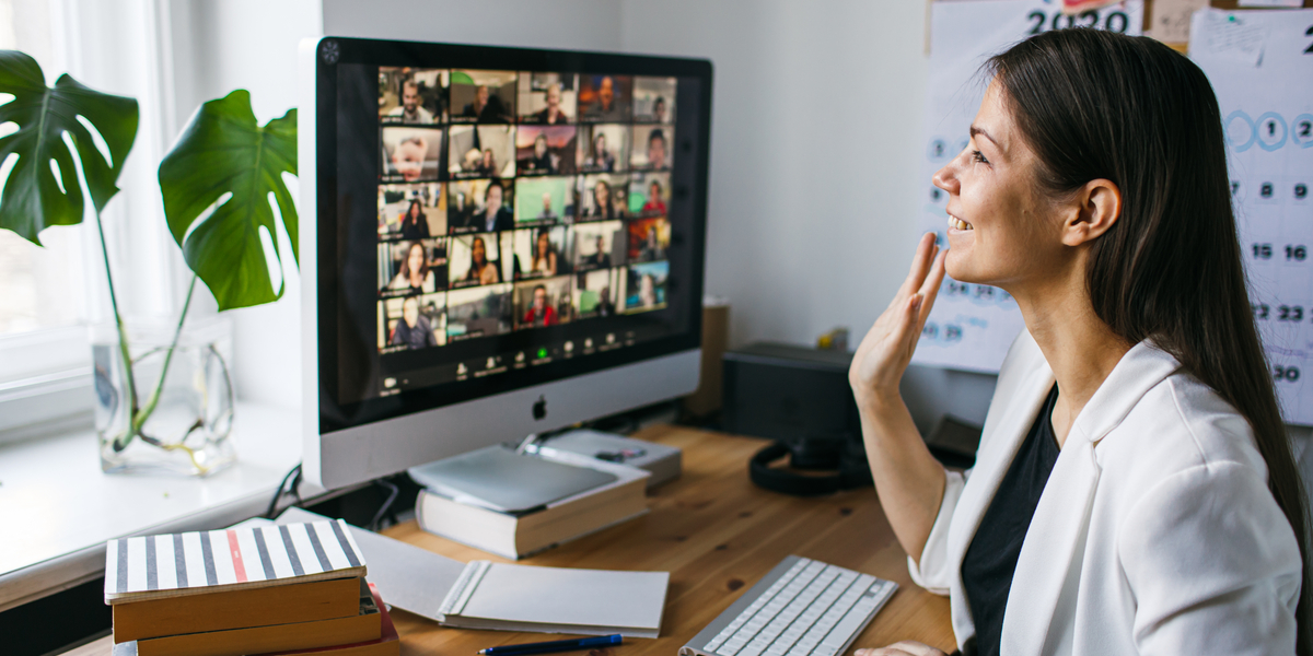 A person looking at a recorded Zoom meeting