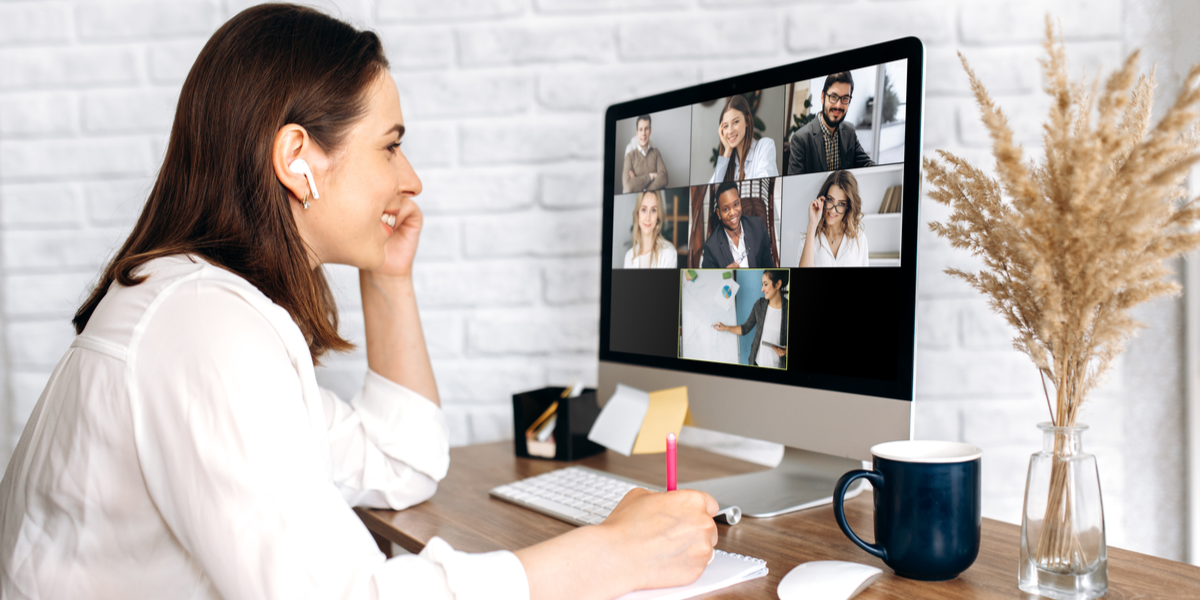 A remote worker using a remote technology to communicate with her team.