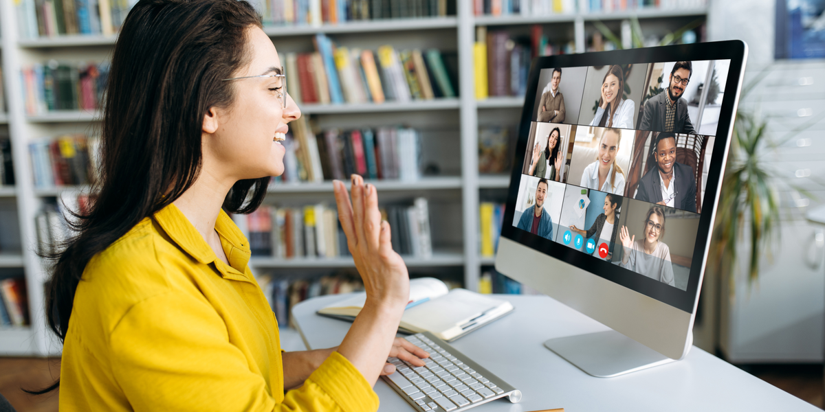 An employee attending a video conferencing meeting securely.