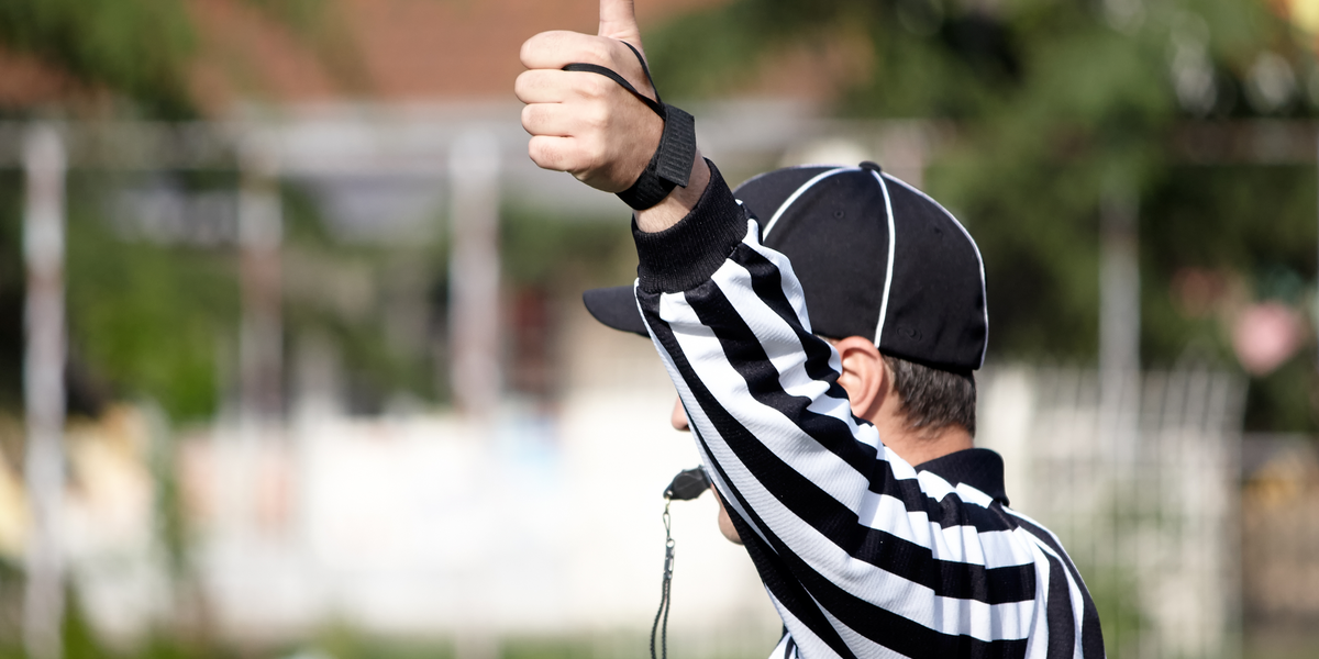 A referee raising hand during an online training video