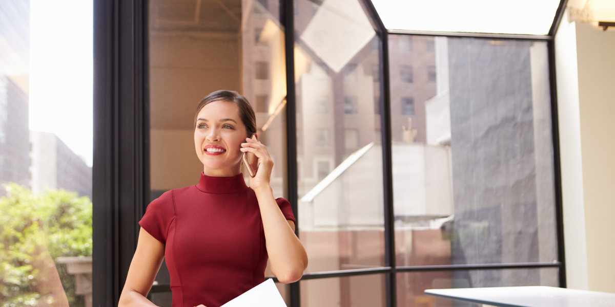 A woman on a phone in the office